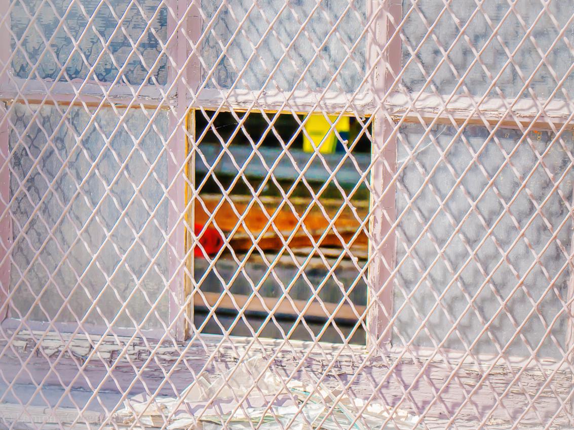 behind a broken window